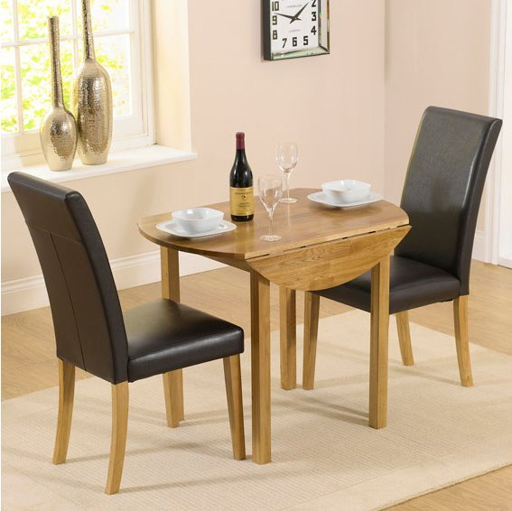 Solid Oak Round Drop Leaf Table 2 Black Chairs